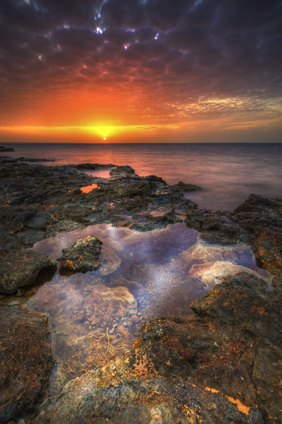 Artem Nosenko: sunset water rocks