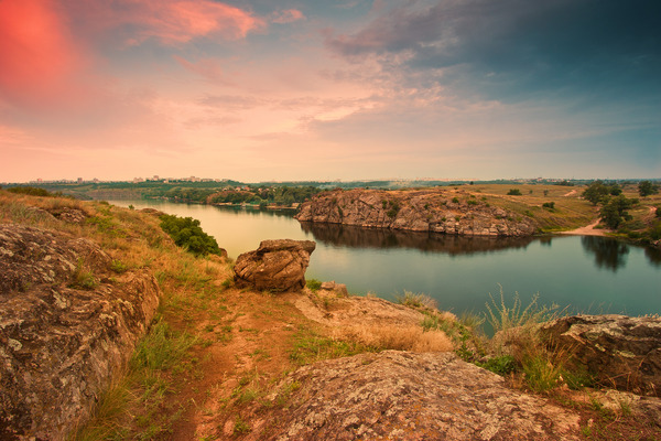 Artem Nosenko: rocks stones river water grass city sky